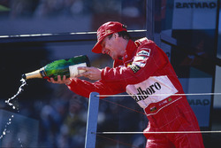 Podium: winner Eddie Irvine, Ferrari celebrates
