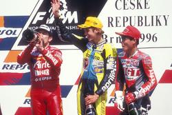 Podium: race winner Valentino Rossi, Aprilia, second place Jorge Martinez, Aprilia, third place Tomomi Manako, Honda