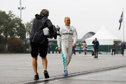 Valtteri Bottas, Mercedes AMG, is filmed arriving in the paddock