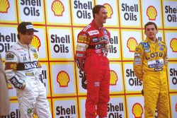 Podium: race winner Nigel Mansell, Williams, second place Nelson Piquet, Williams, third place Ayrton Senna, Team Lotus
