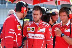 Sebastian Vettel, Ferrari, Riccardo Adami, Ferrari Race Engineer and Antti Kontsas, trainer