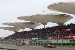 Fernando Alonso, McLaren MCL32, leads Sergio Perez, Force India VJM10