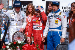 Gilles Villeneuve, 1st position, Jody Scheckter, 2nd position and Alan Jones, 3rd position on the podium
