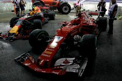 The damaged cars of Max Verstappen, Red Bull Racing RB13 and Kimi Raikkonen, Ferrari SF70H after cra