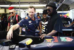 Christian Horner, Team Principal, Red Bull Racing, shows the Black Eyed Peas around the team's garage