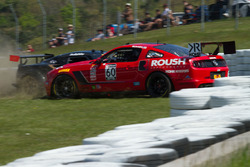 #60 Roush Performance Ford Boss 302 and #46 SDR Motorsports Lotus Evora making contact és each other