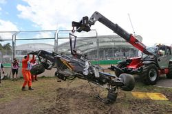 The McLaren MP4-31 of Fernando Alonso, McLaren is removed from the gravel trap after his race stoppi