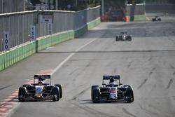 (L to R): Carlos Sainz Jr., Scuderia Toro Rosso STR11 and Fernando Alonso, McLaren MP4-31 battle for