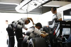 McLaren team members at work in the garage