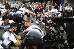 The McLaren team conduct a practice pit stop