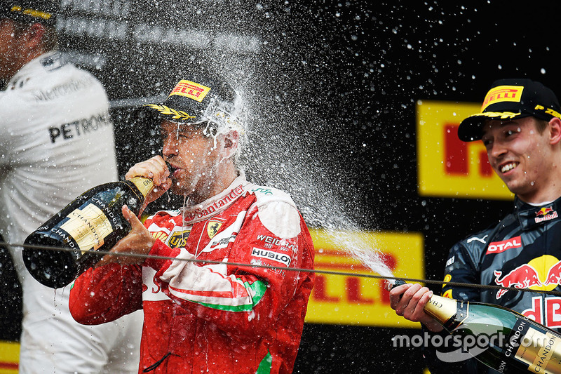Подіум: друге місце - Себастьян Феттель, Ferrari, третє місце - Данііл Квят, Red Bull Racing