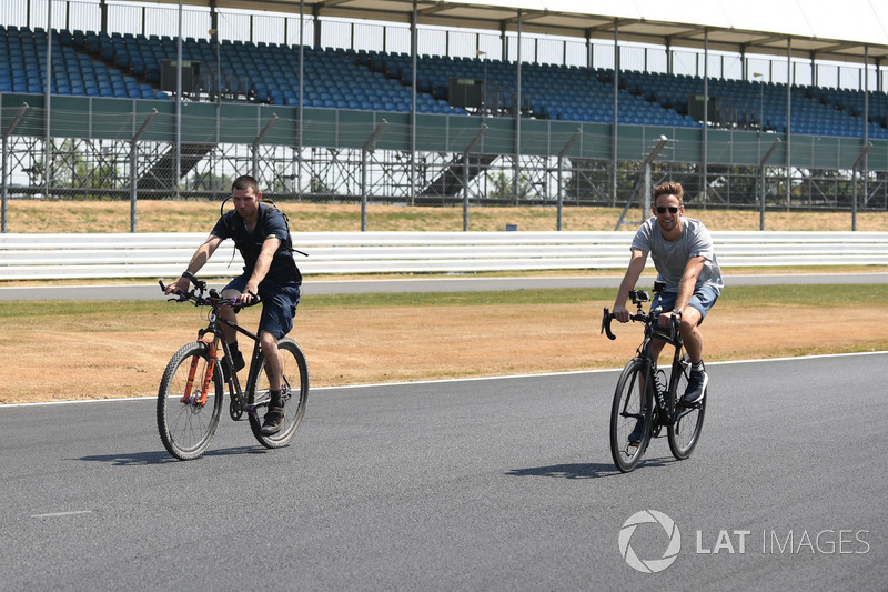 Guy Martin and Jenson Button, McLaren cycle on the track