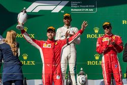 Sebastian Vettel, Ferrari celebrates on the podium with the trophy watched by Lewis Hamilton, Mercedes-AMG F1 and Kimi Raikkonen, Ferrari