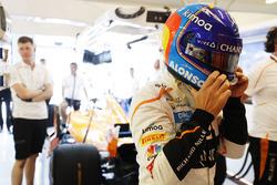 Fernando Alonso, McLaren, puts on his helmet in the garage