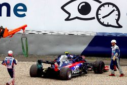 Marshals attend to Pierre Gasly, Toro Rosso STR13, after he suffered broken suspension