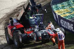 Marshals remove the car of Romain Grosjean, Haas F1 Team VF-18 Ferrari, from the circuit
