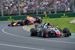 Kevin Magnussen, Haas F1 Team VF-18 as Max Verstappen, Red Bull Racing RB14 spins