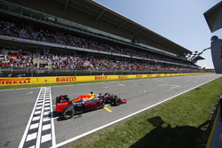 Max Verstappen, Red Bull Racing RB12 TAG Heuer takes the chequered flag at the finish