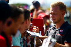 Kevin Magnussen, Haas F1 Team, signs autographs and has his picture taken by fans