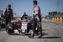 The car of Sergio Perez, Sahara Force India VJM10 is pushed by mechanics
