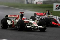 Rubens Barrichello, Honda RA106 with Pedro de la Rosa, McLaren Mercedes MP4/21