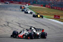 Romain Grosjean, Haas F1 Team VF-18, leads Carlos Sainz Jr., Renault Sport F1 Team R.S. 18