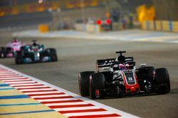 Romain Grosjean, Haas F1 Team VF-18 Ferrari, leads Lewis Hamilton, Mercedes AMG F1 W09