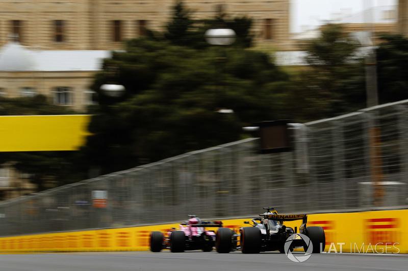 Sergio Perez, Force India VJM11 Mercedes, leads Nico Hulkenberg, Renault Sport F1 Team R.S. 18