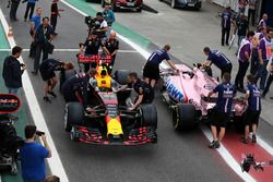 The car of Max Verstappen, Red Bull Racing RB13 and Esteban Ocon, Sahara Force India VJM10 are pushe