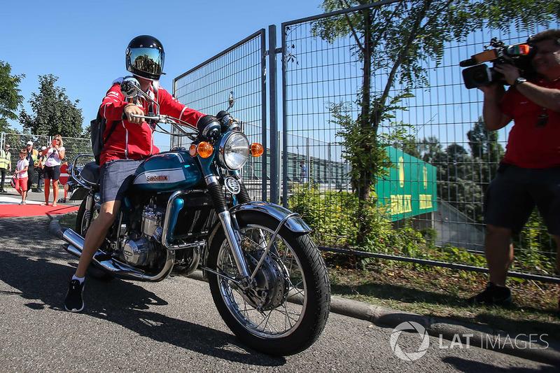 Sebastian Vettel, Ferrari arrives on his Suzuki 750 motorbike