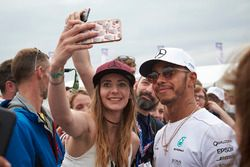 Race winner Lewis Hamilton, Mercedes AMG F1, takes a picture with a fan after the race