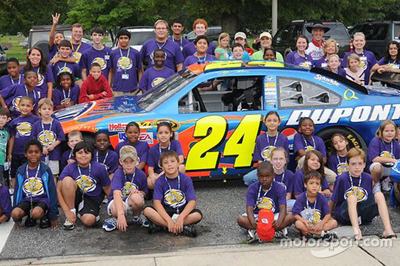 Speedway Children's Charities camp attendees with Jeff Gordon's Chevrolet