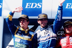 Podium: Race winner Damon Hill, Williams Renault, second place Olivier Panis, Ligier Mugen-Honda, third place Gianni Morbidelli, Footwork Hart