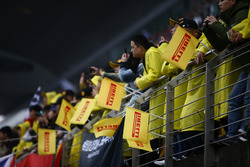 Pirelli flags in the grandstand