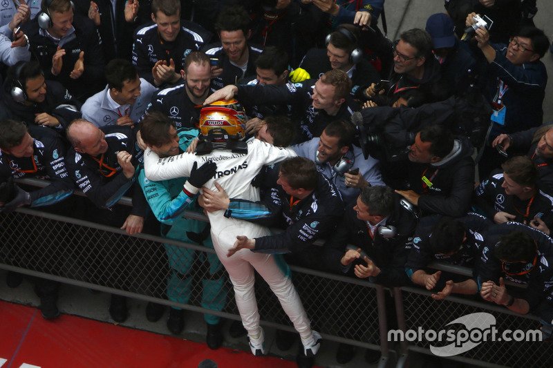 Lewis Hamilton, Mercedes AMG, celebrate in parc ferme with the team