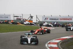 Lewis Hamilton, Mercedes AMG F1 W08, leads Sebastian Vettel, Ferrari SF70H, Valtteri Bottas, Mercedes AMG F1 W08