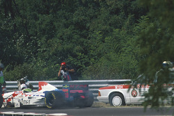 Taki Inoue, Arrows FA16 is knocked down by a medical car after trying to put out a fire