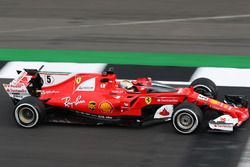 Sebastian Vettel, Ferrari SF70H, tests a new protective wind shield