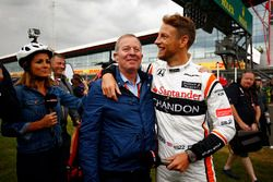 Jenson Button, McLaren, greets Sky pundit Martin Brundle