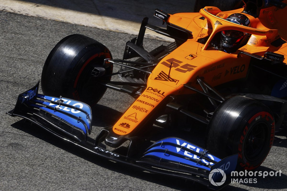 Carlos Sainz Jr., McLaren MCL35, leaves the garage