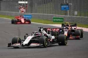 Romain Grosjean, Haas VF-20, leads Alex Albon, Red Bull Racing RB16, and Sebastian Vettel, Ferrari SF1000