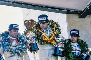 Race Winner Alan Jones, Williams, Jochen Mass, Arrows, 2nd position, and Elio de Angelis, Lotus, 3rd position, on the podium