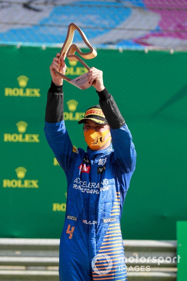 Lando Norris, McLaren celebrates on the podium with the trophy