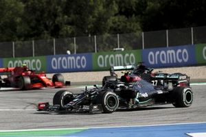 Valtteri Bottas, Mercedes F1 W11 EQ Performance, leads Lewis Hamilton, Mercedes F1 W11 EQ Performance, and Charles Leclerc, Ferrari SF1000