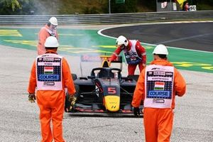 Marshals attend to the smoking car of Liam Lawson, Hitech Grand Prix Liam Lawson, Hitech Grand Prix retires with a smoking car and is attended to by marshals