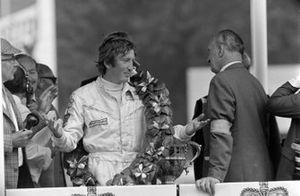 Race winner Jochen Rindt on the podium
