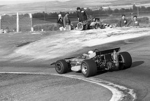 Jackie Stewart, March 701, passes the burnt out wreck of Jackie Oliver, BRM after first lap accident with Jacky Ickx, Ferrari. BRM Team Manager Tim Parnell inspects the damage