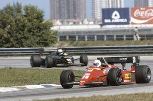 René Arnoux, Ferrari 126C4, leads Elio de Angelis, Lotus 95T Renault
