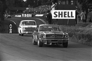 Jack Brabham, Ford Mustang, leads Jim Clark, Lotus Ford Cortina