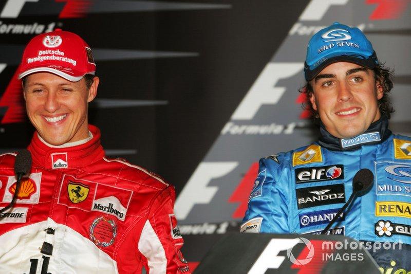 Michael Schumacher, Ferrari e il vincitore della gara Fernando Alonso, Renault durante la conferenza stampa dopo la gara